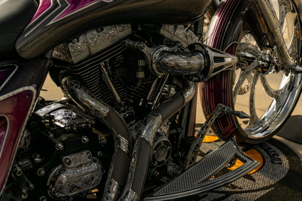 A close-up view of the metal filigree on David Moreno's custom purple-and-black 2013 Harley-Davidson Street Glide bike's V-twin engine