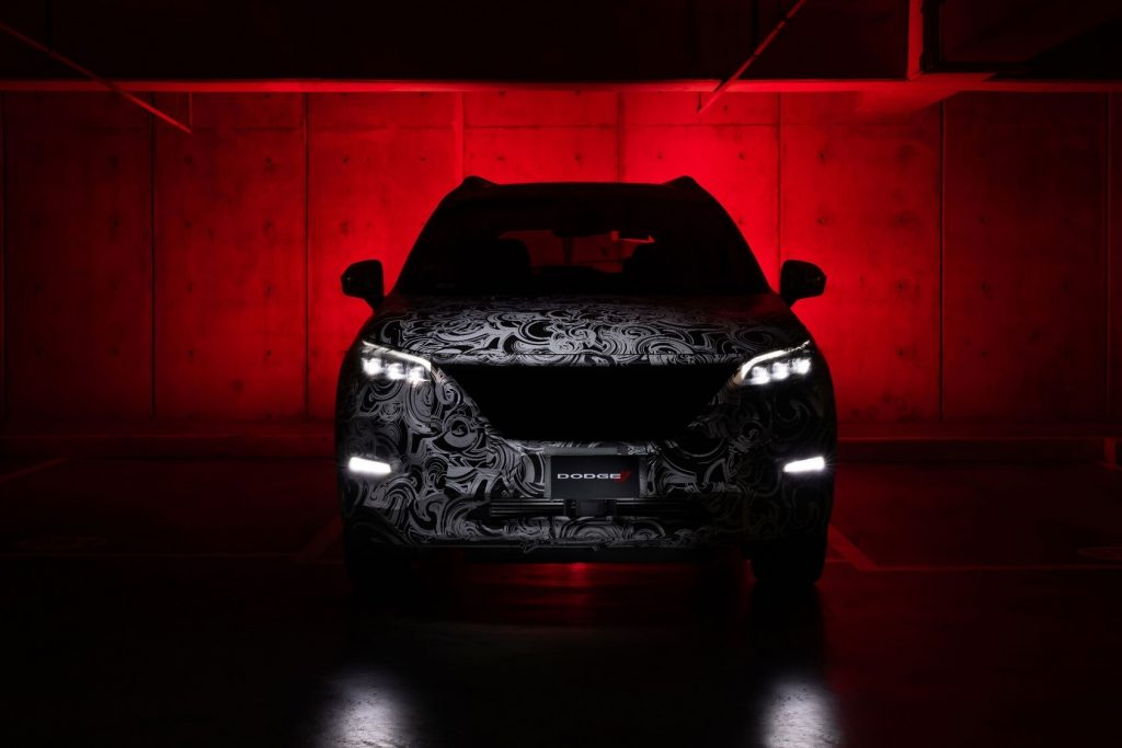 New Dodge SUV is teased in the dark, camouflaged.
