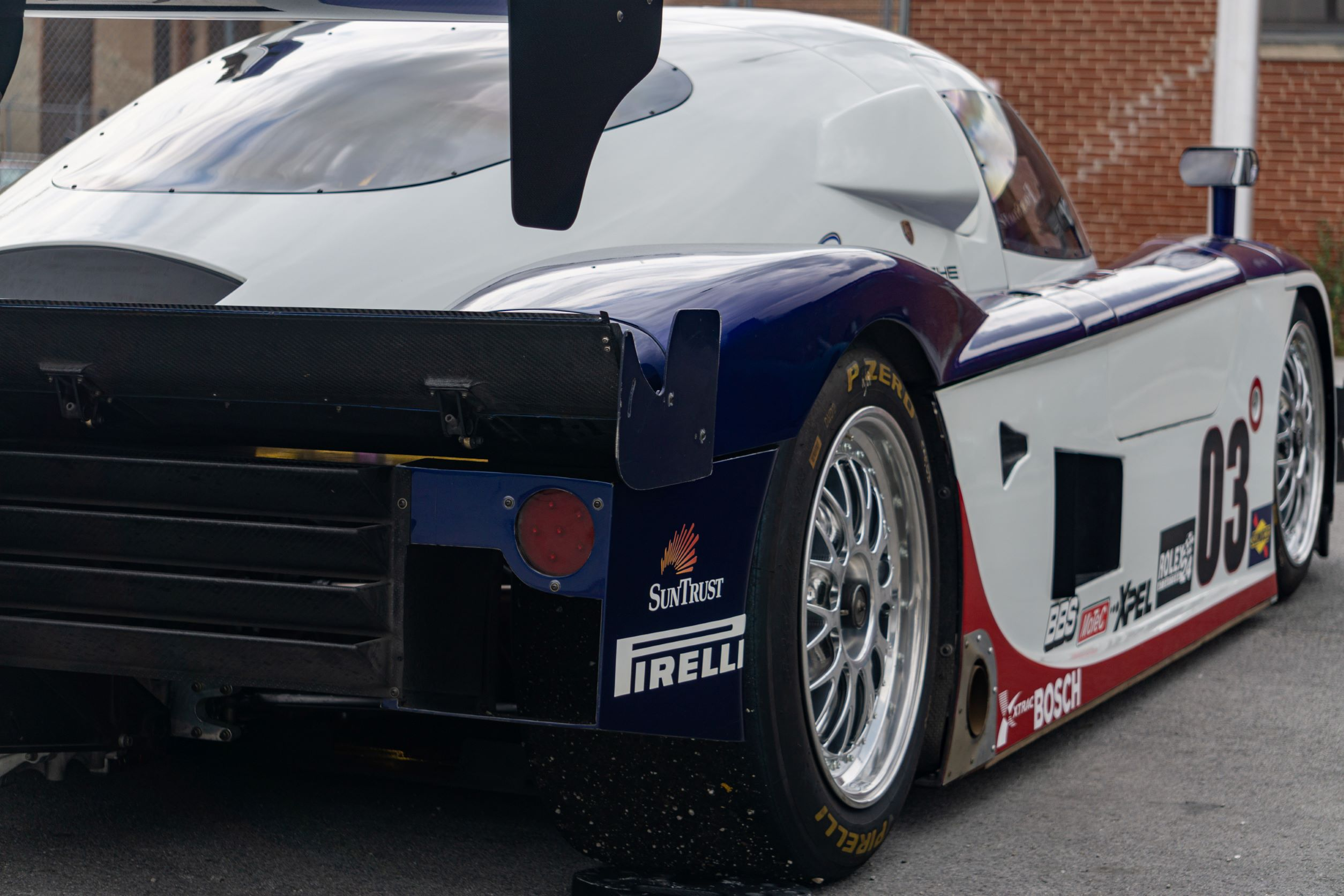 The rear 3/4 view of Fall-Line Motorsports' white-red-and-blue Porsche Crawford Daytona Prototype