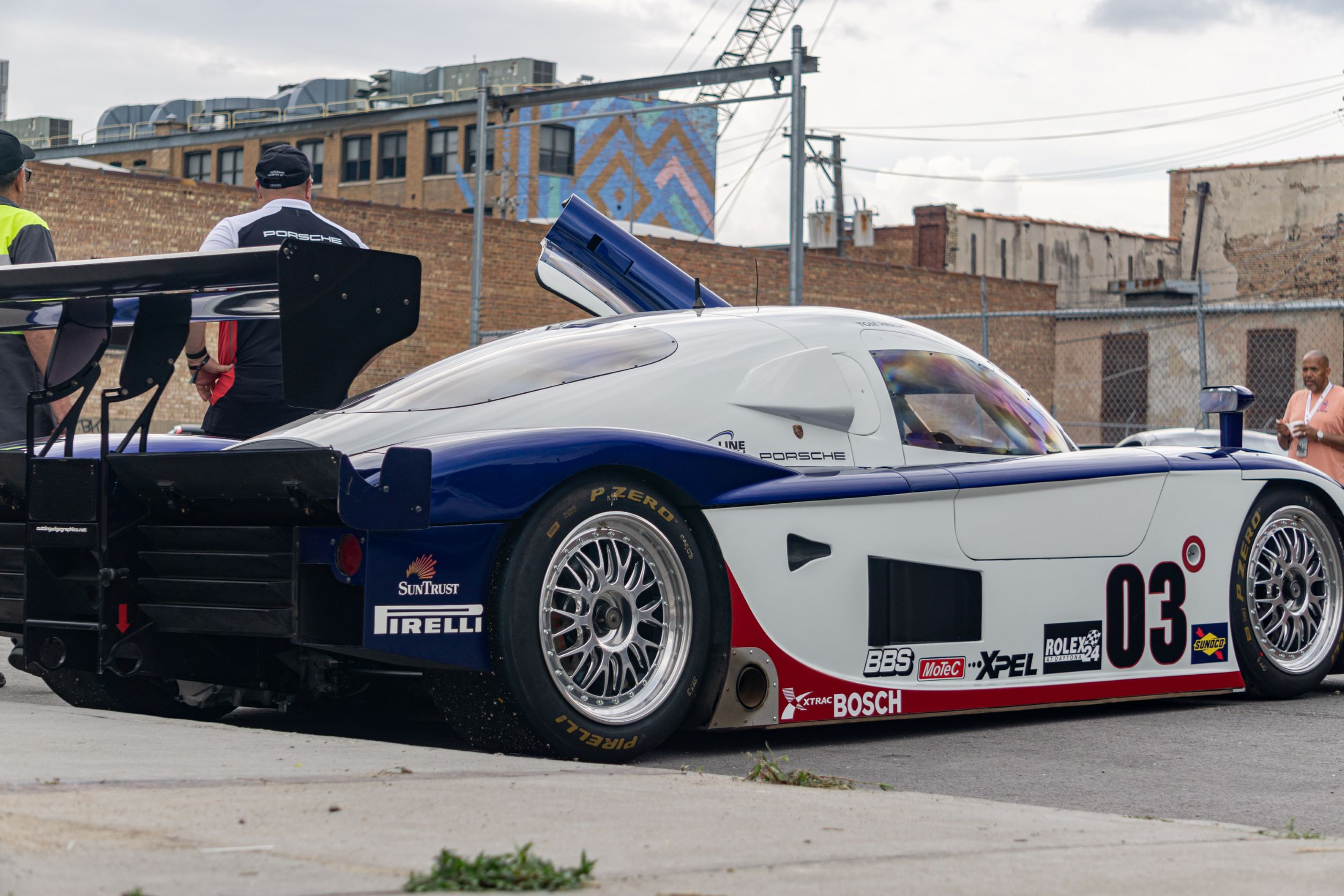 The side 3/4 view of a white-blue-and-red Fall-Line Motorsports' Porsche Crawford Daytona Prototype