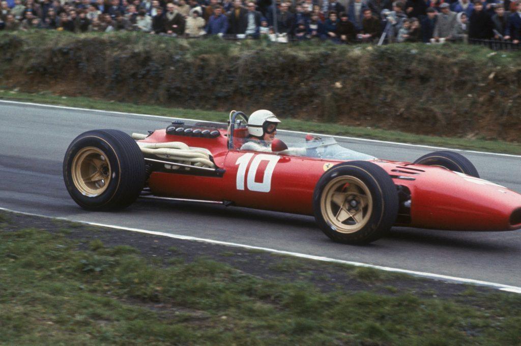 A photo of a real 1967 Ferrari 312 in a race
