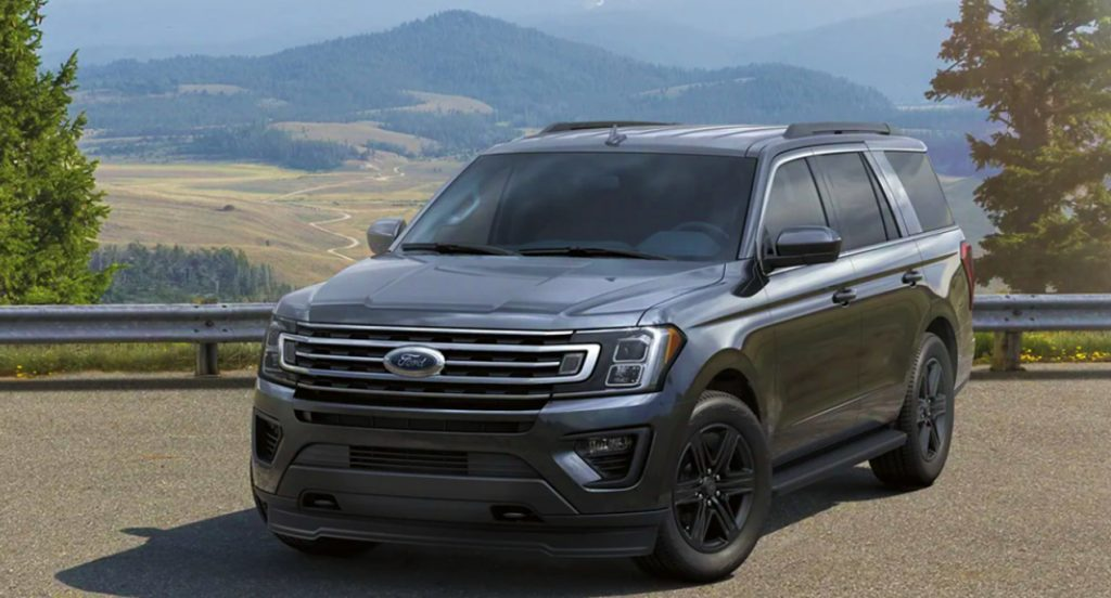 A black Ford Expedition SUV is parked on the road.