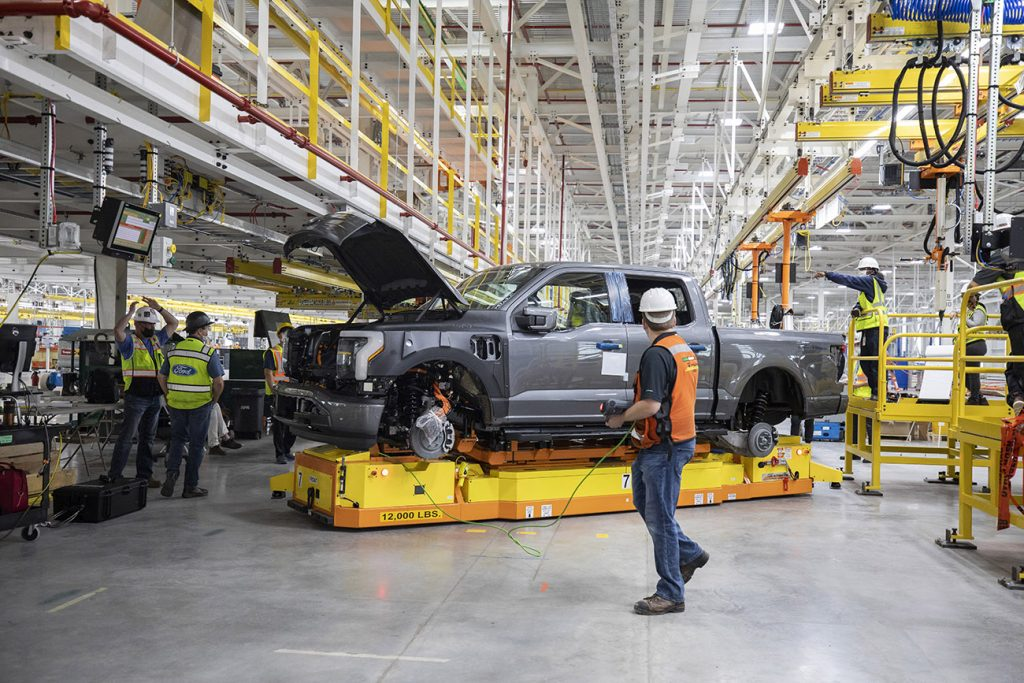 Ford F-150 Lightning being assembled in a factory.