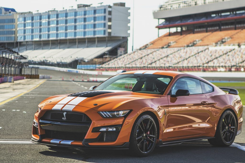 orange 2020 Ford Mustang Shelby GT500 similar to the car used in the drag race featured in this article