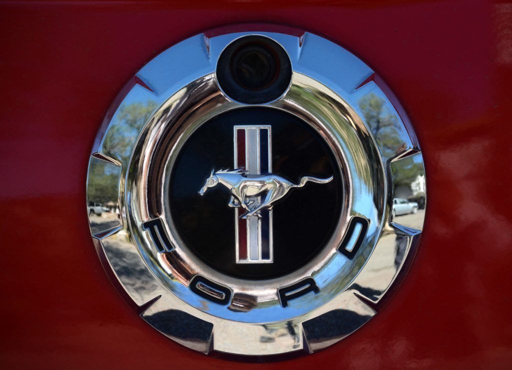 Makers of the Ford Mustang Shelby logo on a red car.
