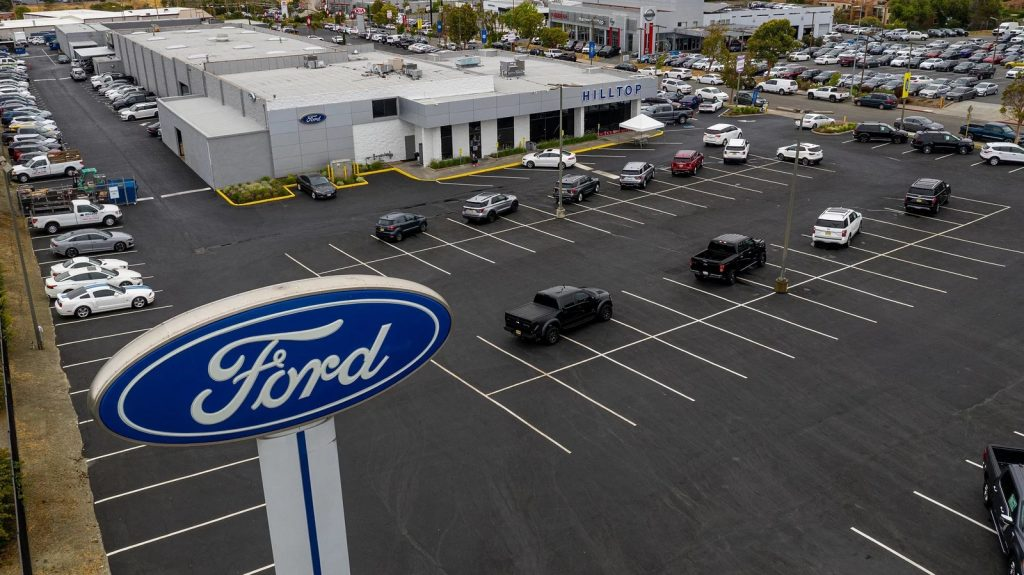 An empty Ford dealership shows that now is not the best time to buy a car. Buying a car right now will be tough.