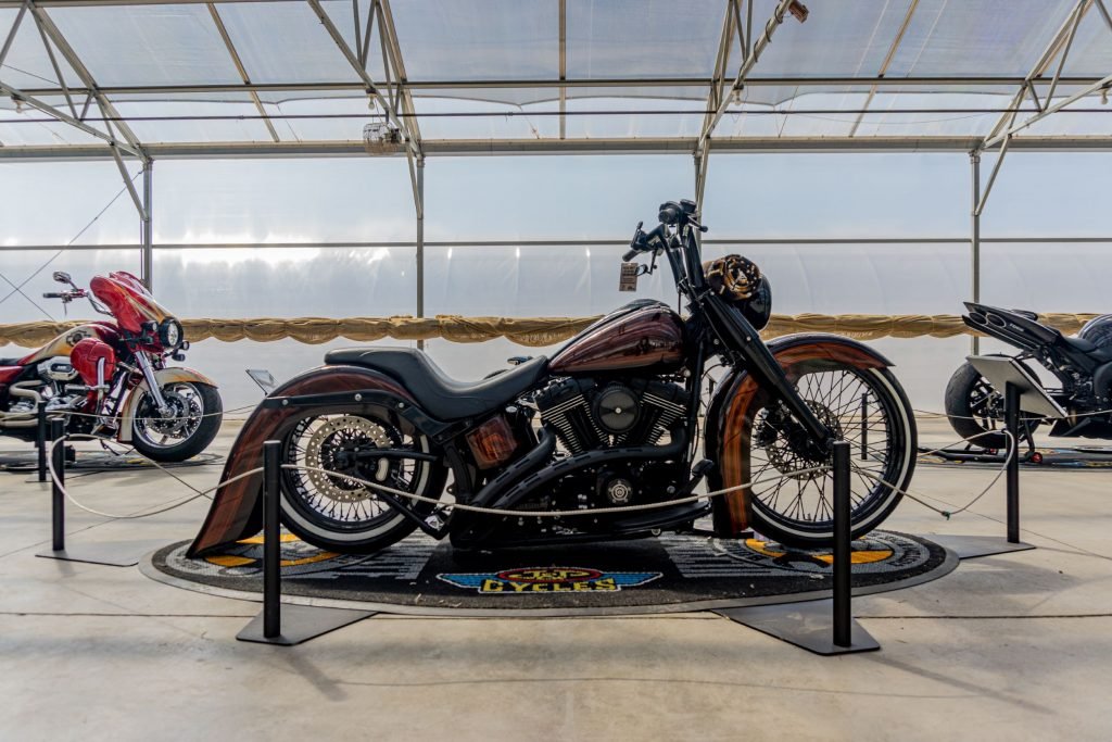 Fornarelli Motorsports' custom 2010 Harley-Davidson Fat Boy Lo next to two other custom bikes at IMS Outdoors Chicago 2021