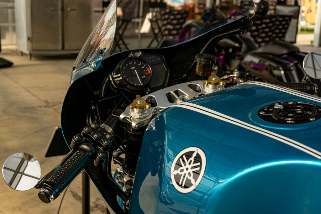 A closeup view of Robert Catanese's blue Framecrafters 2021 Yamaha YZF-R1 R1X's handlebars and gauges