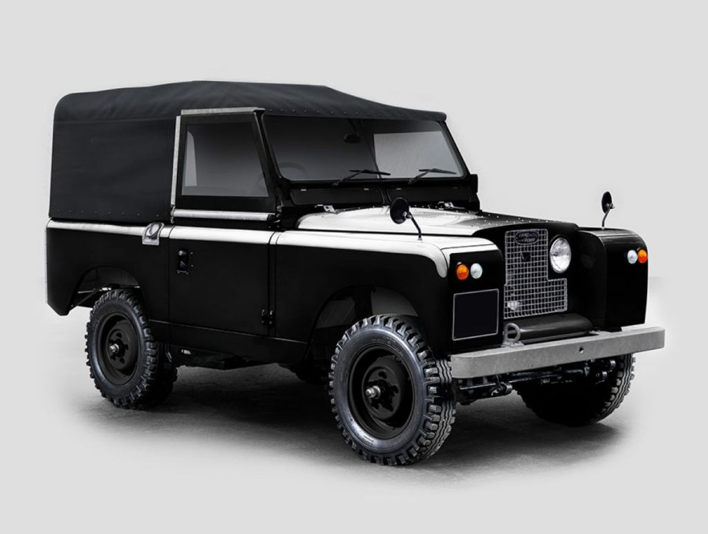 Front angle view of modified electric black Land Rover Series IIA