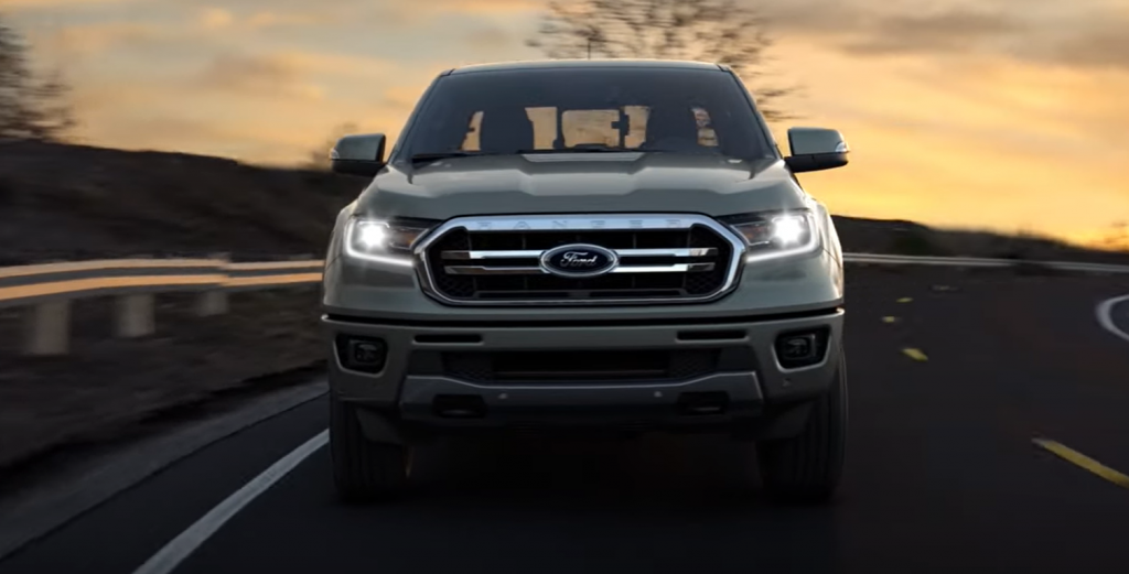 Front view of gray Ford Ranger with the headlamps turned on