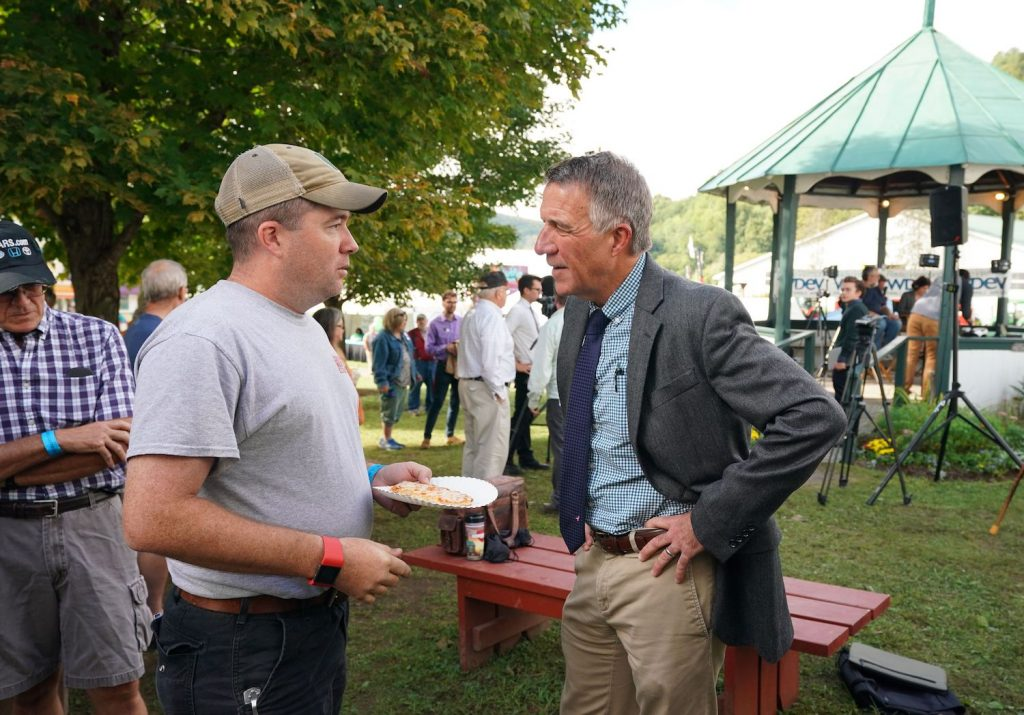 Vermont Governor Phil Scott greets voters following a debate with Vermont Democratic gubernatorial challenger Christine Hallquist September 14, 2018 at the Tunbridge World's Fair in Tunbridge, Vermont. - Hallquist is the first openly transgender person nominated for governor by a major party in the United States, defying death threats to take the political fight to Donald Trump. (Photo by Don EMMERT / AFP)        (Photo credit should read DON EMMERT/AFP via Getty Images). Governor Phil Scott is a race car driver and Vermont set a COVID vaccination record.