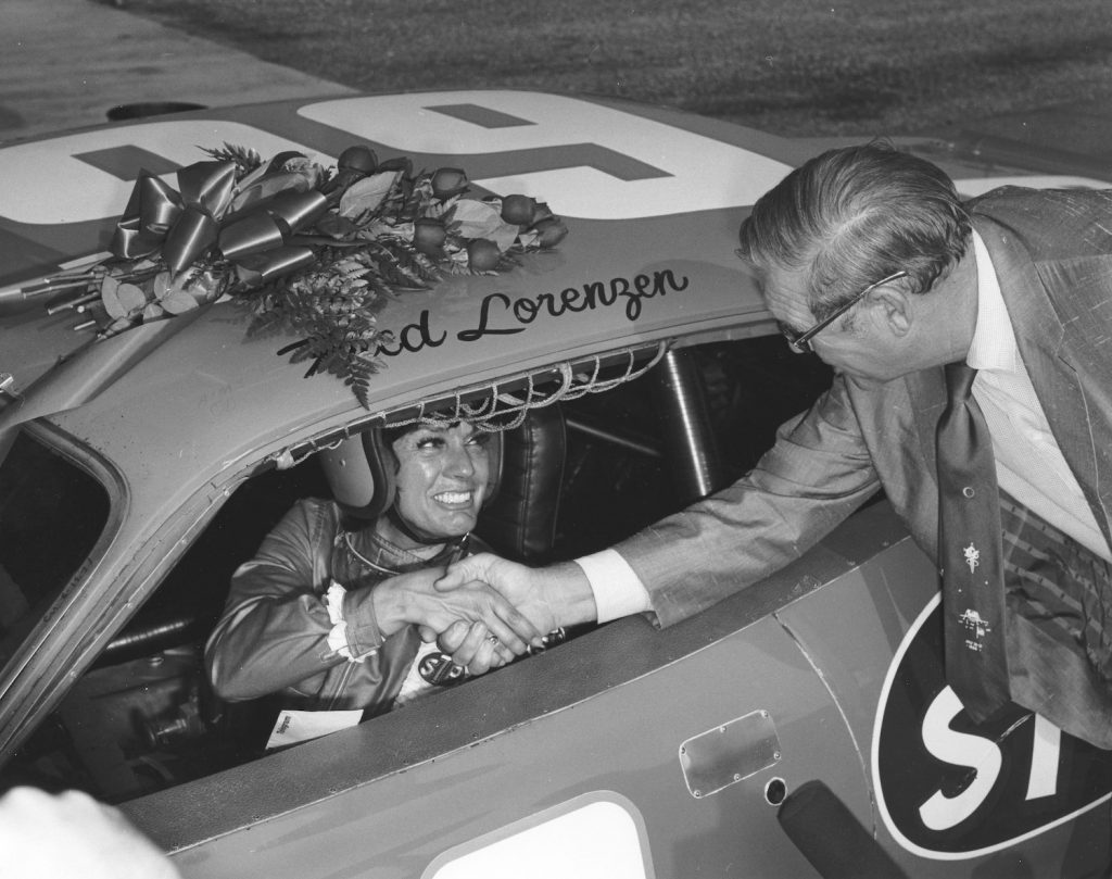 Paula Murphy and NASCAR President Bill France, Sr. before her record-setting Talladega run. Talladega Superspeedway is NASCAR's fastest track | Photo by ISC Images & Archives via Getty Images