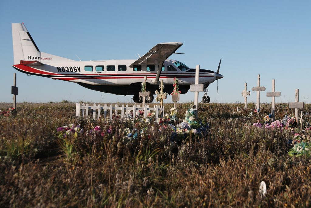 A Ravn connect commuter plane in Alaska parked on the dirt runway in the town of Kivalina, next to the town's cemetary. Alaska has the highest rate of deadly plane crashes in the country. | Joe Raedle/Getty Images
