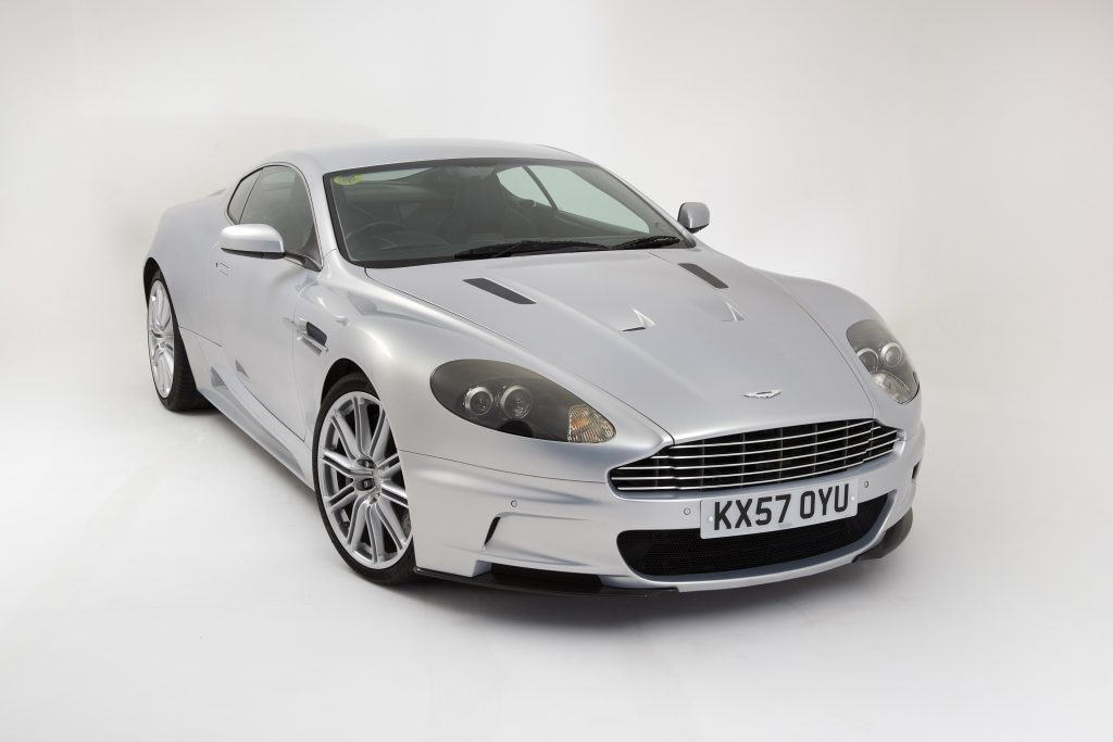 A silver 2009 Aston Martin DBS in a photo booth at the National Motor Museum