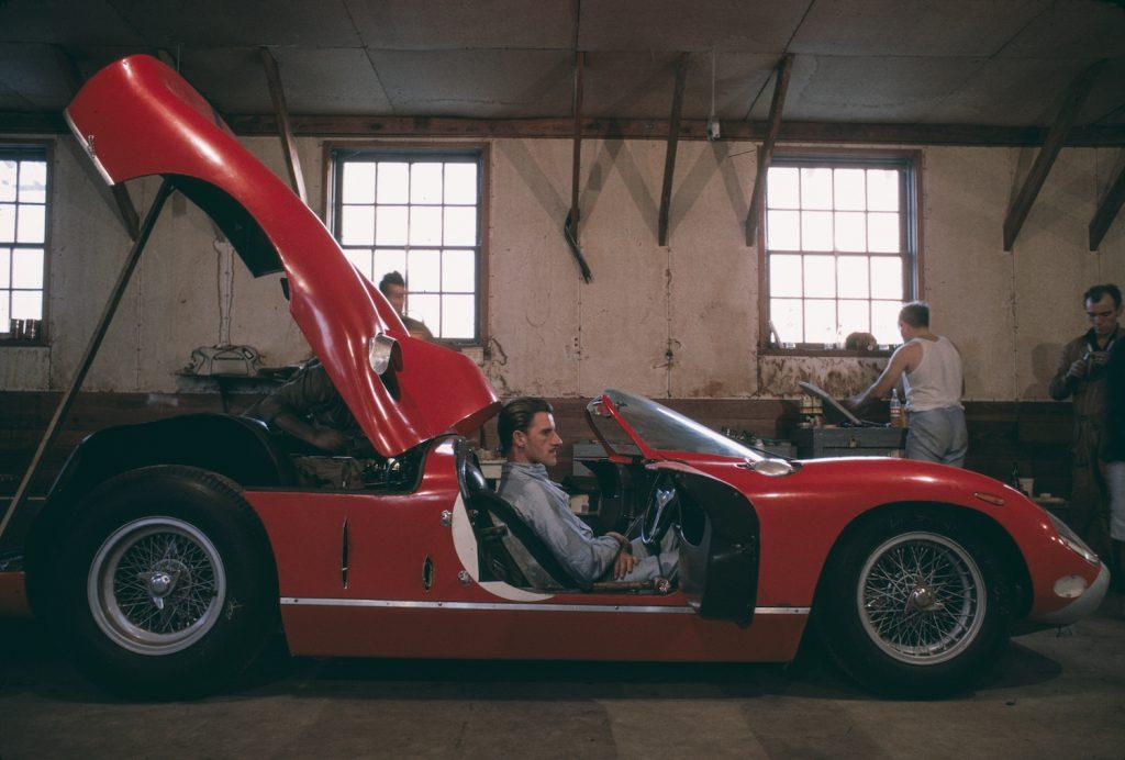 English motor racing driver Graham Hill, sitting in a Ferrari car at a performance garage at Sebring International Raceway, 1964. (Photo by Flip Schulke/Getty Images) EU combustion ban may affect new ferrari, lamborghini, and porsche supercars.