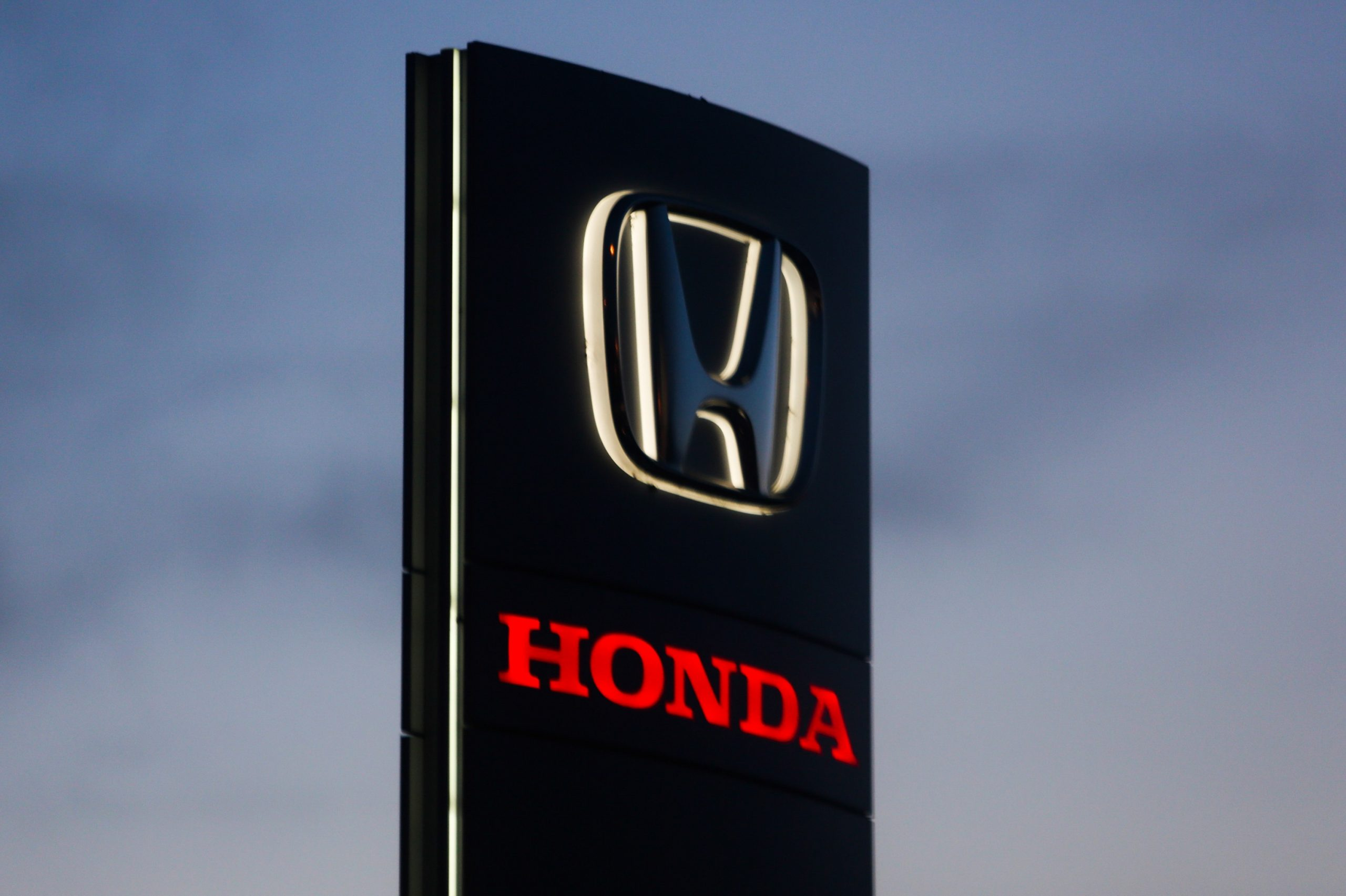 A red Honda Logo on a sign in Poland