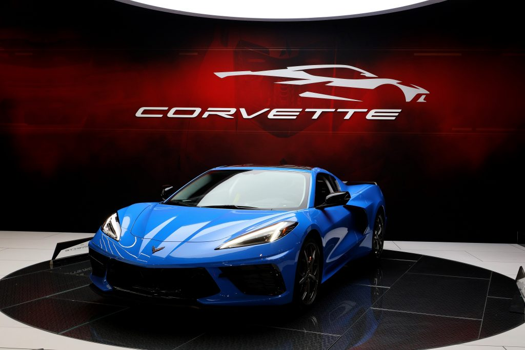 A blue C8 Corvette at an Auto show shot from the front 3/4 angle