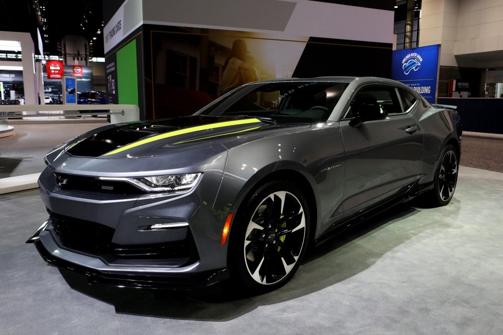 A grey Chevy Camaro in the booth at an auto show