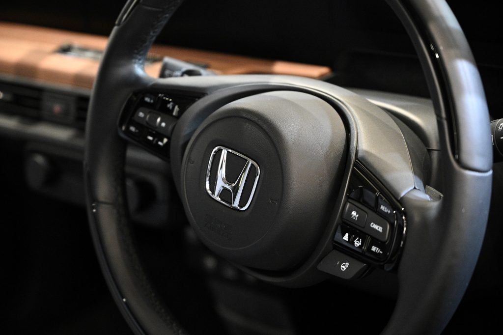 A Honda logo is pictured from a displayed car at a Honda showroom of company's headquarters in Tokyo.