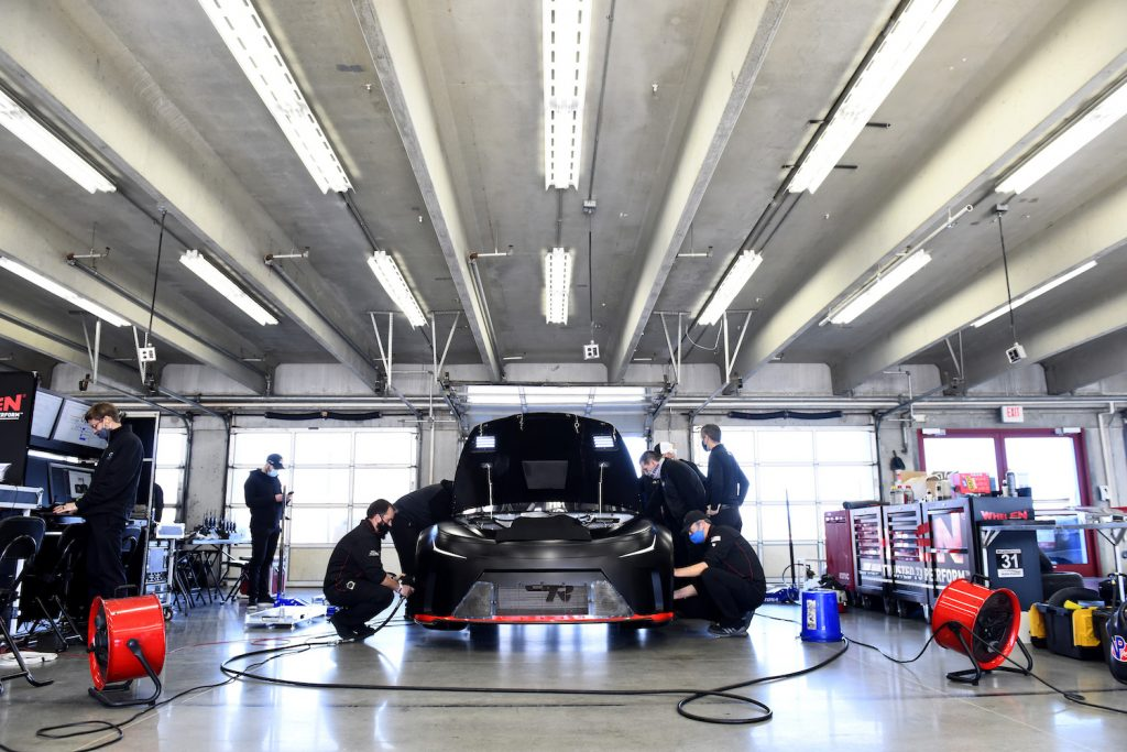 Team members adjusting a NASCAR Next Gen car. Drivers are complaining that NASCAR's Next Gen Cars Are Too Hot To Drive   Jared C. Tilton/Getty Images