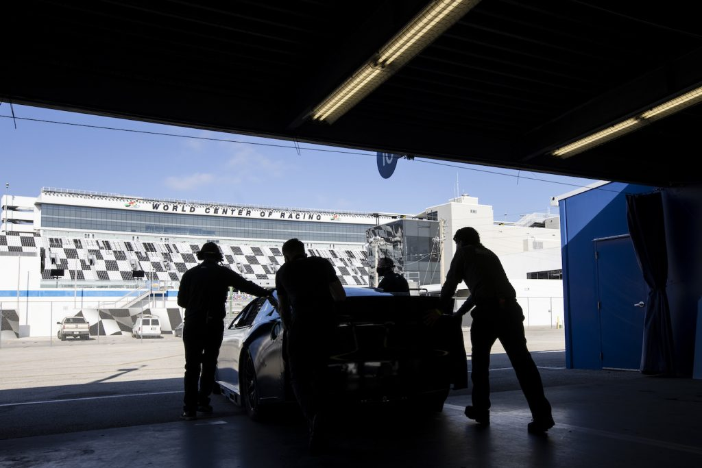 DAYTONA BEACH, FLORIDA - DECEMBER 15: Team members push the NASCAR Next Gen car out of the Garage during the NASCAR Cup Series test at Daytona International Speedway on December 15, 2020 in Daytona Beach, Florida. (Photo by James Gilbert/Getty Images). Next Gen NASCAR car.