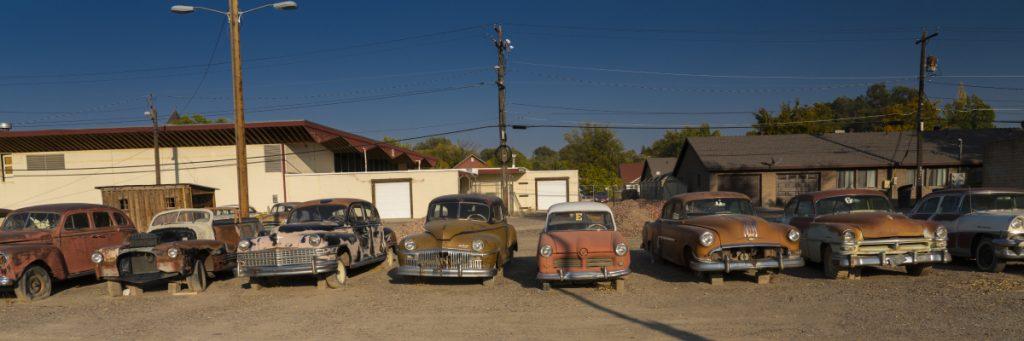 used cars, rusted trucks