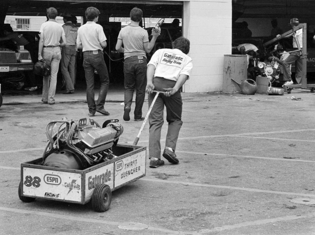 Bobby Allison's pit crew pulls an engine into the Daytona International speedway garage prior to a race. Because of improved aerodynamics, NASCAR Next Gen engines are allowed to make hundreds more horsepower than outgoing engines. | Robert Alexander/Getty Images