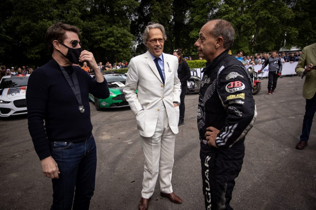CHICHESTER, ENGLAND - JULY 11: Tom Cruise talks with Terry Grant and Lord March  during the Goodwood Festival of Speed at Goodwood on July 11, 2021 in Chichester, England. (Photo by James Bearne/Getty Images)