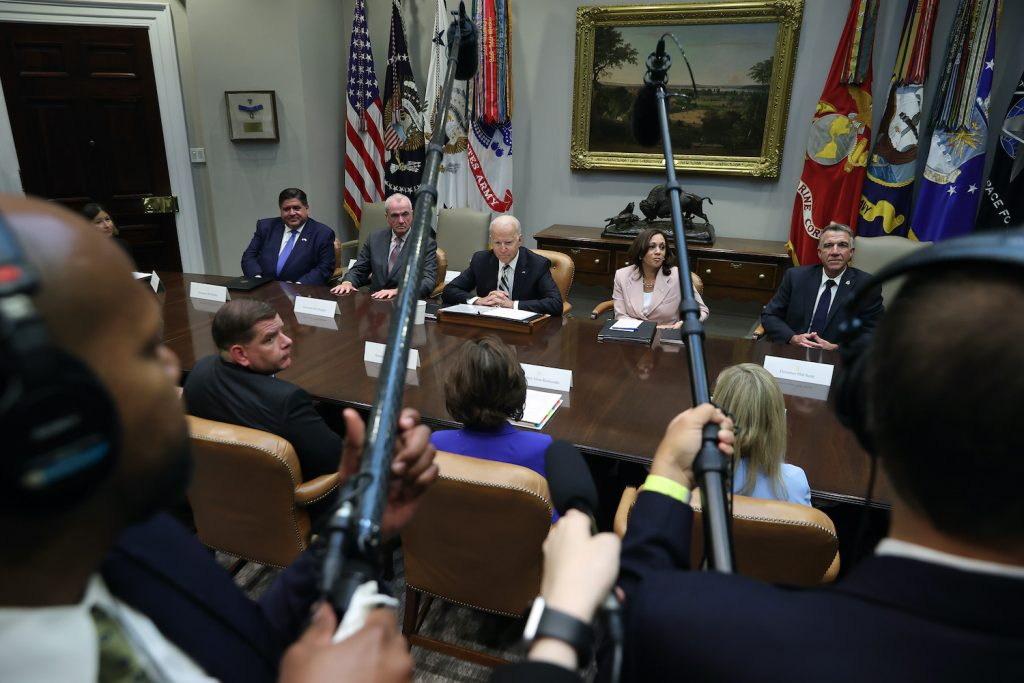 WASHINGTON, DC - JULY 14: U.S. President Joe Biden and Vice President Kamala Harris (R) meet with a bipartisan group of city and state political leaders, including New Jersey Governor Phil Murphy, Vermont Governor Phil Scott and Illinois Governor JB Pritzker, about his proposed infrastructure plan in the Roosevelt Room at the White House on July 14, 2021 in Washington, DC. Commerce Secretary Gina Raimondo and Labor Secretary Martin Walsh also attended the meeting. (Photo by Chip Somodevilla/Getty Images). Governor Phil Scott of Vermont is a race car driver and Vermont set a record for COVID vaccinations.