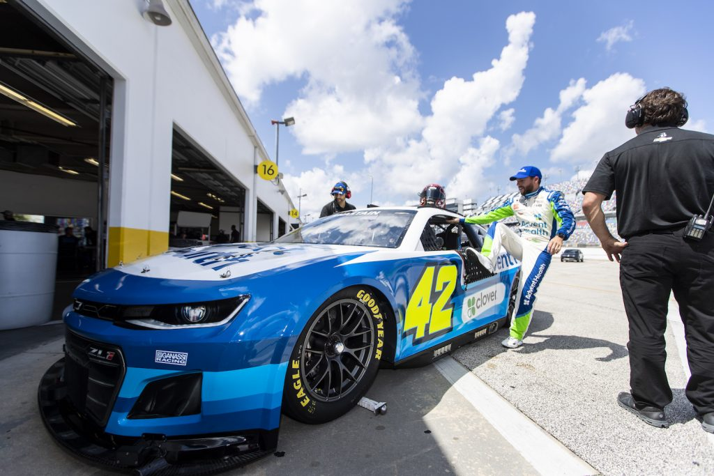 DAYTONA BEACH, FLORIDA - SEPTEMBER 07: Ross Chastain, Driver of the #42 NASCAR Next Gen car, gets in his car during the NASCAR Cup Series test at Daytona International Speedway on September 07, 2021 in Daytona Beach, Florida. (Photo by James Gilbert/Getty Images). Next Gen NASCAR car.