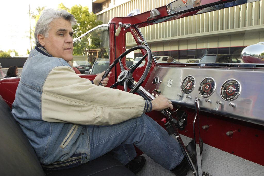 """THE TONIGHT SHOW WITH JAY LENO -- Episode 3348 -- Pictured: Host Jay Leno drives away in one of his many """"automobiles,"""" a vintage collector red fire engine, after the show on April 16, 2007 -- Photo by: Paul Drinkwater/NBCU Photo Bank"""