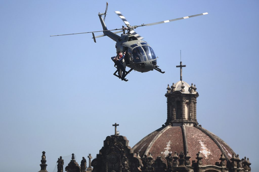 This is a picture of stuntmen as they perform a battle hanging from a helicopter during the filming of the James Bond movie 'Spectre' at Zocalo Main Square in Mexico City, Mexico. The Spectre fight is one of many memorable James Bond helicopter scenes.   Hector Vivas/LatinContent/Getty Images