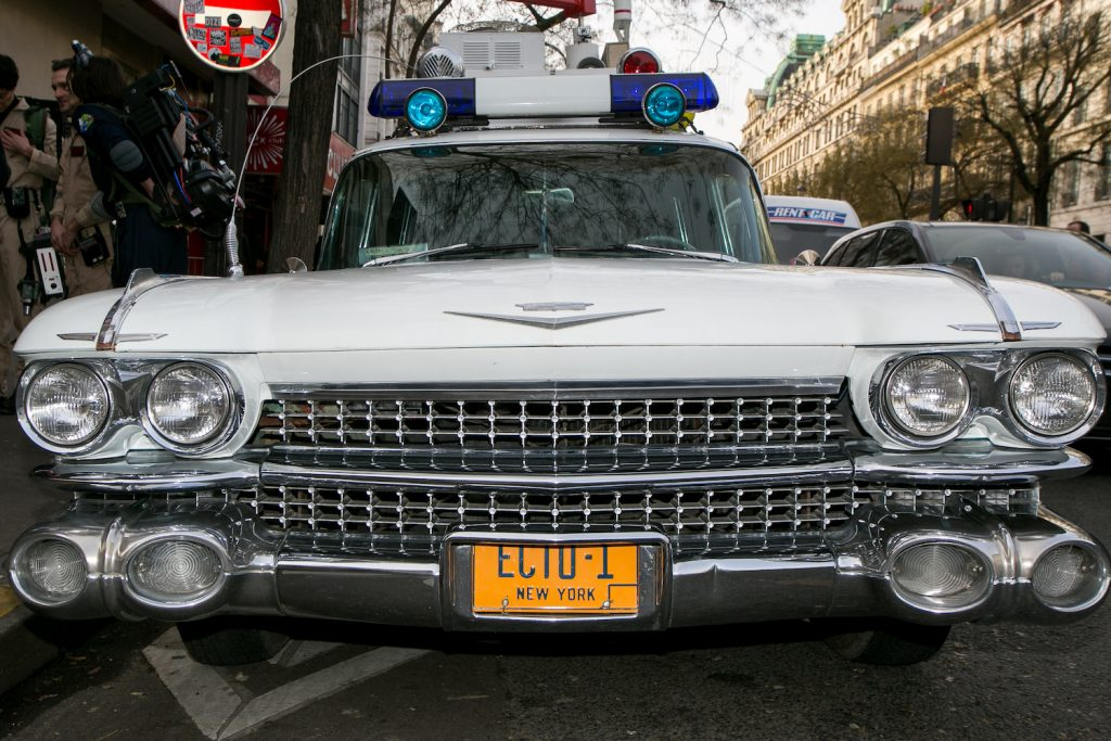 Ectomobile replica vehicle owned by a Ghostbusters fan. The Ghostbusters car, known as the ectomobile or ecto 1, is based on a 1959 Cadillac ambulance, a hearse in the movie. The original film car survives to this day and will appear in Ghostbusters: Afterlife. | Marc Piasecki/Getty Images