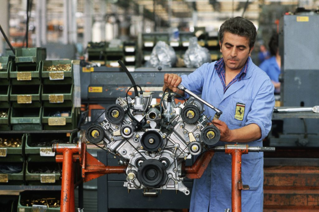 An engineer works on a Ferrari engine at the factory in Maranello, Italy. (Photo by �� Vittoriano Rastelli/CORBIS/Corbis via Getty Images). EU combustion ban may affect the engines in future Ferrari, Lamborghini and Porsche supercars.