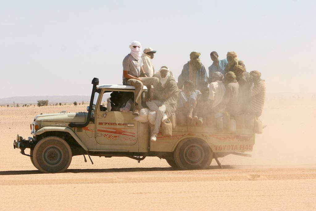 A Toyota Land Cruiser loaded with passengers and luggage drives to the Niger city of Agadez. Instead of building an electric Toyota Tundra, the world's largest automaker engineered a next generation internal combustion drivetrain that will sell in the U.S. as well as markets such as Niger.   Markus Matzel via Getty Images