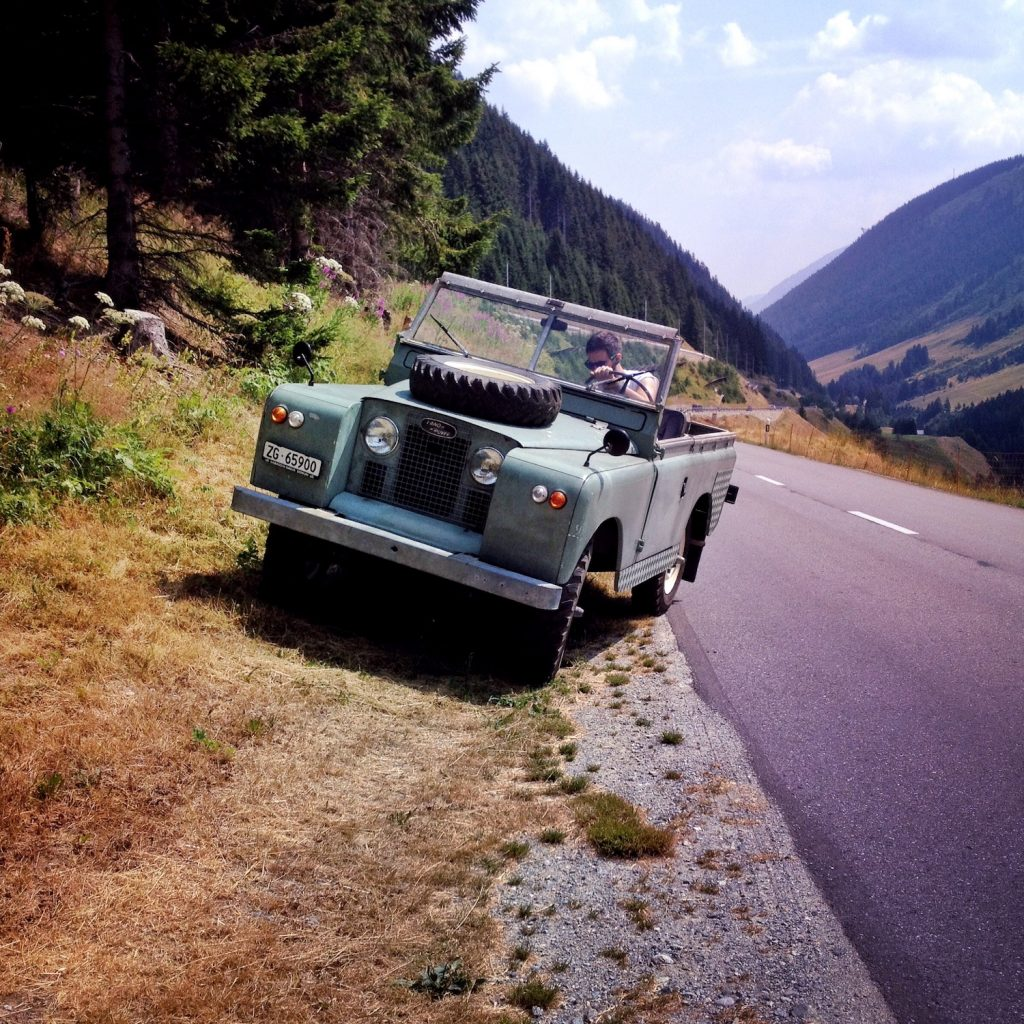 This is a vintage Land Rover Series 4x4 car like James Bond drives in No Time To Die
