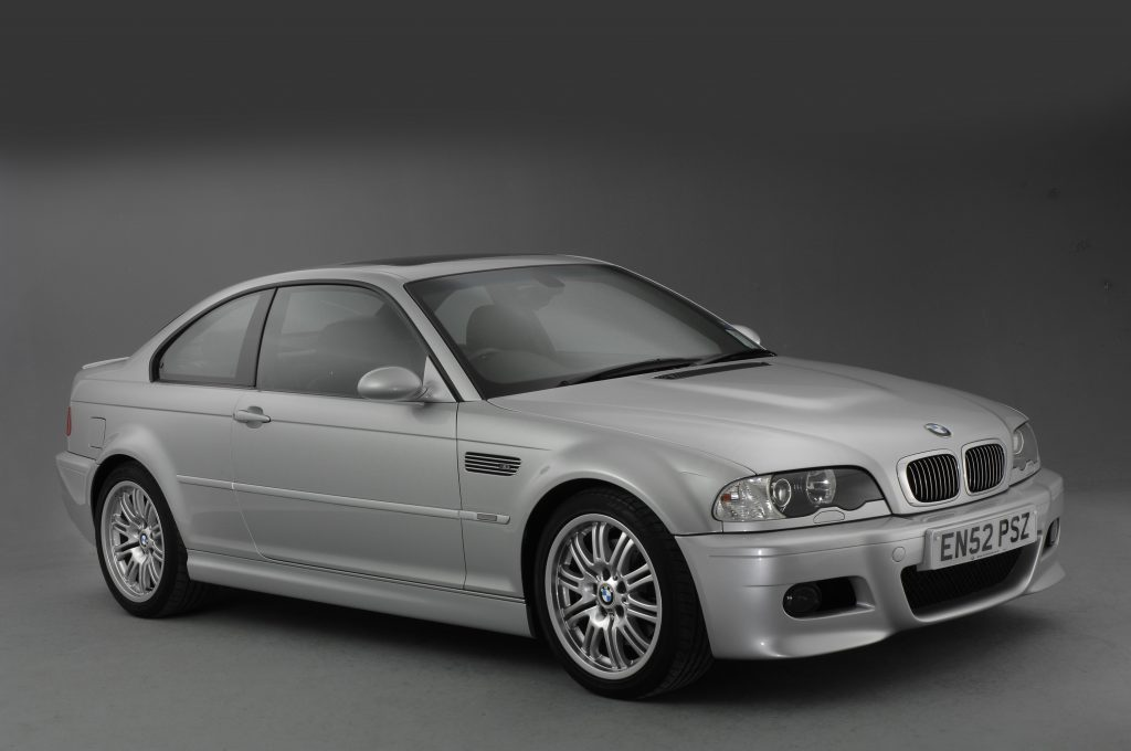 A Silbergrau metallic BMW M3 E46 in a studio booth, photographed from the front 3/4