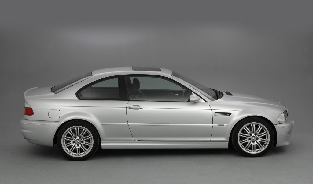 A side profile of a silver 2002 BMW M3