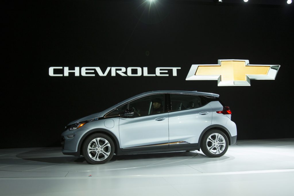 The Chevrolet Bolt drives onstage during a press conference at the 2017 North American International Auto Show in Detroit. Chris Pratt drives a 2017 Chevy Bolt in The Tomorrow War as part of GM's Ultium product placement   GEOFF ROBINS/AFP via Getty Images