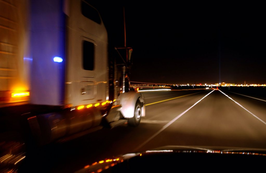 400728 15: A truck speeds through the night February 6, 2002 on Interstate 15, west of Las Vegas, NV. Interstate 15 is a primary proposed route for transporting radioactive waste from across the nation to the proposed nuclear waste dump site of Yucca Mountain, located approximately 90 miles north of Las Vegas. Although the route would skirt around downtown Las Vegas, many residents dislike the idea of shipping 70,000 tons of nuclear waste over nearby highways and railroads. In January, the U.S. Department of Energy endorsed the Yucca Mountain plan. U.S. President George W. Bush could annouce his support for the plan as early as this week. (Photo by David McNew/Getty Images). Many drivers use this highway to set the 2020 Cannonball Run record.