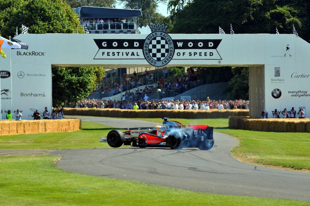 Lewis Hamilton driving a McLaren MP4/23 F1 car, performs wheel spins as he takes part in the hill climb event at the Goodwood Festival of Speed in Chichester, West Sussex.   (Photo by Clive Gee/PA Images via Getty Images)