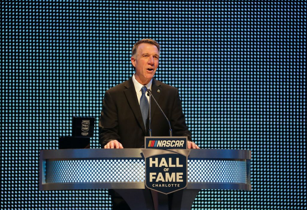 CHARLOTTE, NC - JANUARY 19: Governer of Vermont, Phil Scott, speaks during the NASCAR Hall of Fame Induction Ceremony at Charlotte Convention Center on January 19, 2018 in Charlotte, North Carolina. (Photo by Streeter Lecka/Getty Images) Governor Phil Scott is a race car driver, Vermont set a COVID vaccination record.