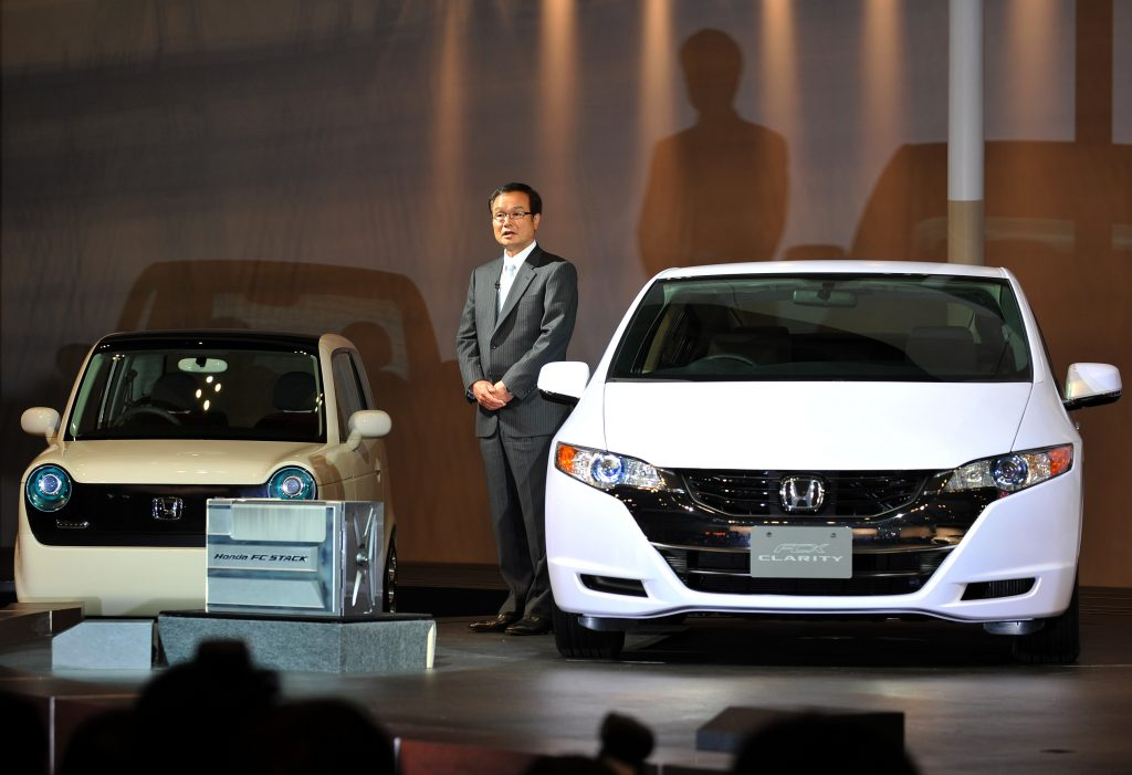 """Honda Motor presents the new concept cars """"EV"""" (L) and the """"FCX Clarity"""" during the Tokyo Motor Show"""