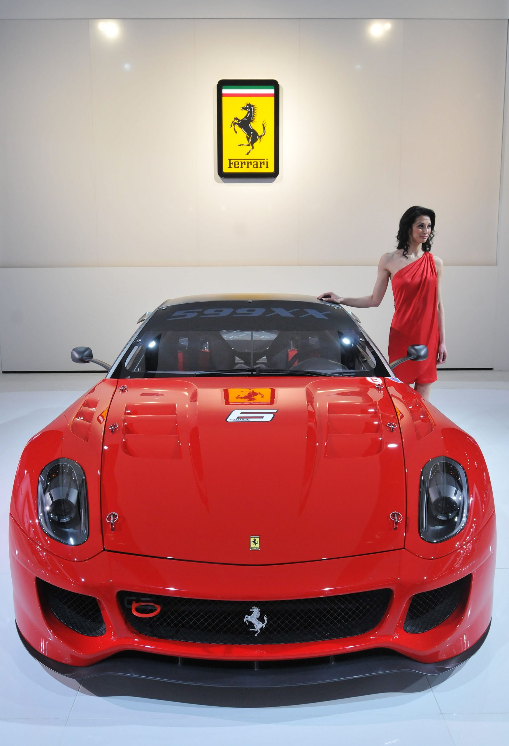 A red Ferrari 599xx Evolution at the Detroit Auto Show, shot from the front