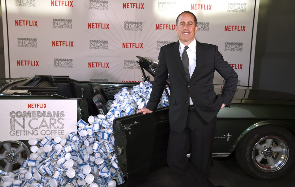 Jerry Seinfeld and a Mustang promo for Comedians in Cars Getting Coffee - New York Event at Classic Car Club Manhattan on June 25, 2018 in New York City. He picked up Seth Rogen in a 1976 Dodge Monaco retired police car. Dimitrios Kambouris/Getty Images for Netflix