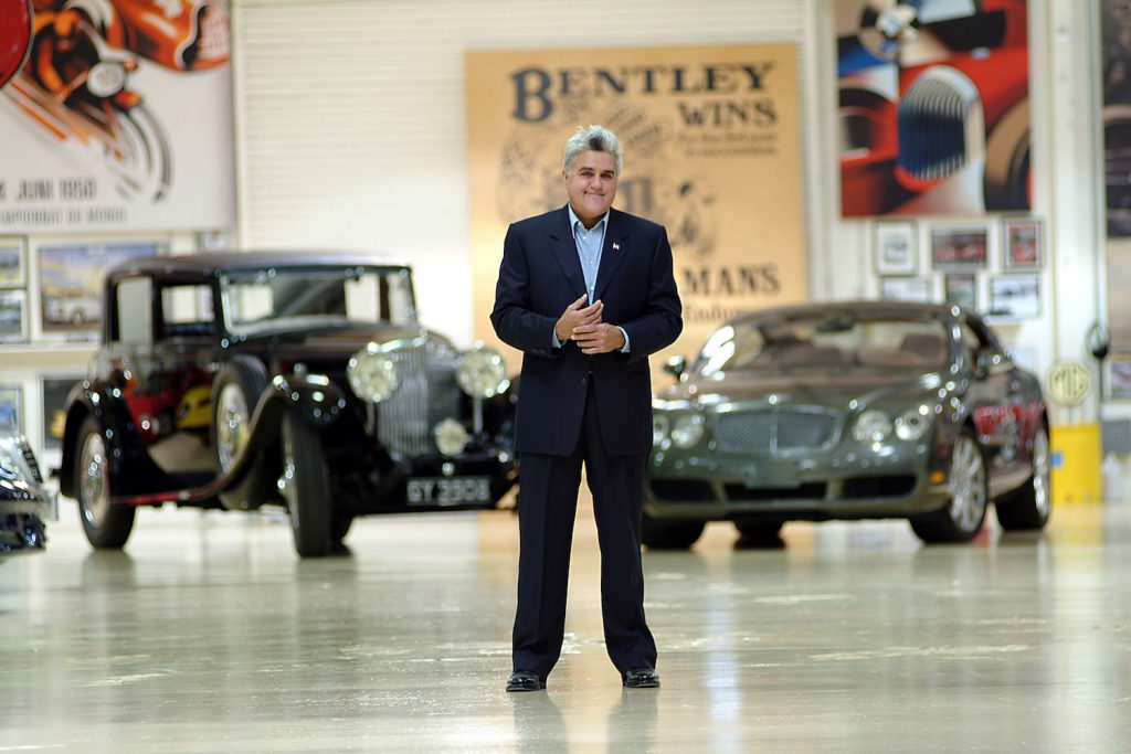 """Jay Leno stands in one of his 3 car storage facilities with a 1931 Straight 8 Bentley he owns and a 2004 Bentley S2 which he roadtested for an Englsih Newspaper. American Television personality Jay Leno who host's the late night NBC """"Tonight Show"""" collects cars. In 3 warehouses in a secure complex on the edge of Burbank airport he has over 100 cars, all insured, all in working order. The collection includes Bentleys, Bugatti's, McClaren, Cadillac, Hispano Suiza, Lamborgini, Morgans, Jaguars, there is also a collection of over 75 working motorcycles from the early 1920""""s to a modern day Jet Bike. Photos Paul Harris, PacificCoastNews.com. The Jay Leno daily driver is a Tesla."""