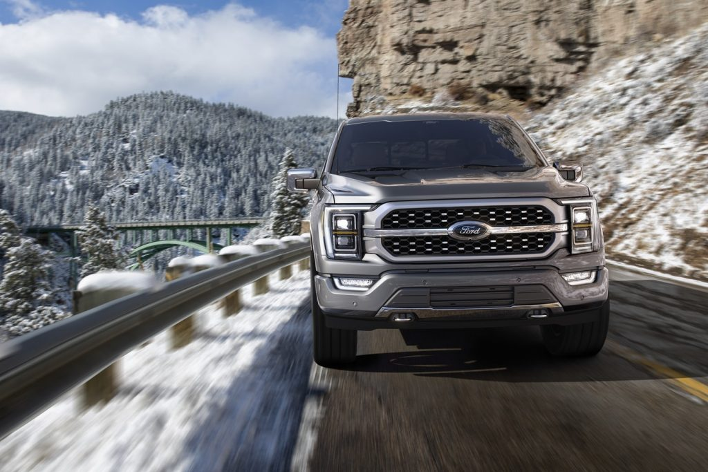 Gray 2022 Ford F-150 driving on a mountainous road