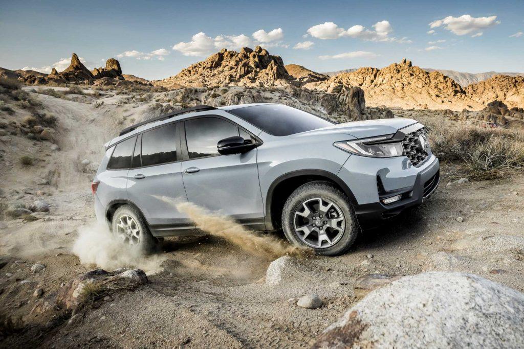 Gray 2022 Honda Passport TrailSport driving on mountainous terrain
