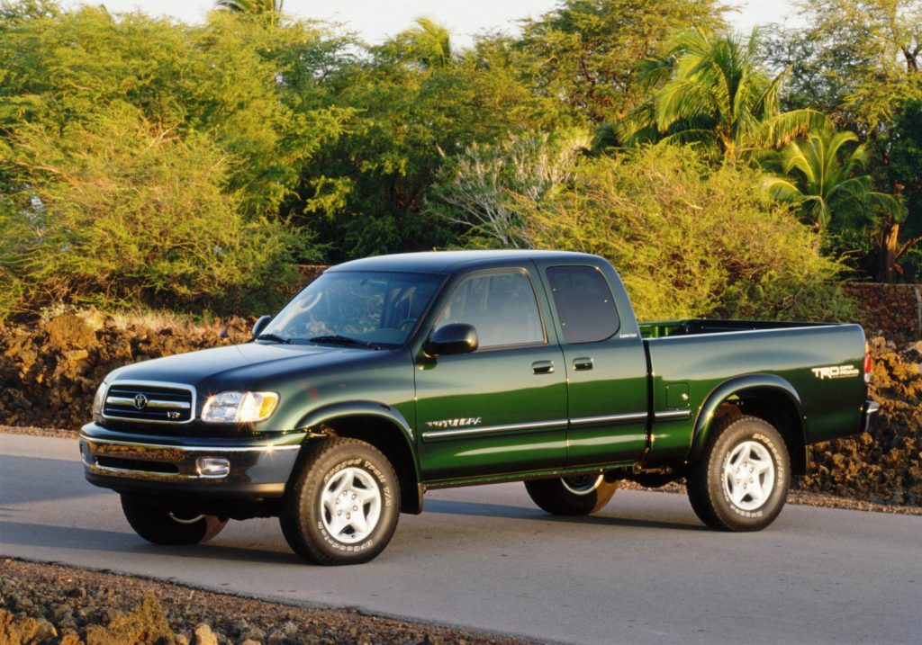 Green 2006 Toyota Tundra parked near a forest