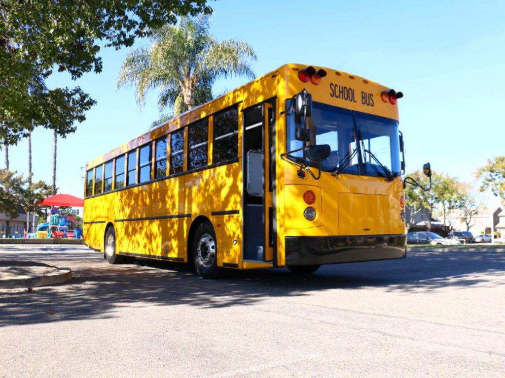 GreenPower BEAST school bus driving in a parking lot